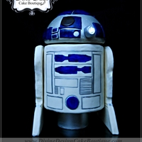 R2D2 Grooms Cake  R2D2 grooms cake with working lights and spinning head. To get a full effect of this cake you must see the video on our facebook fan page!...
