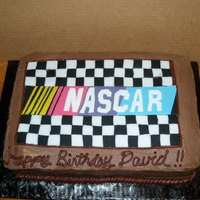 Nascar Birthday Made for my supervisor's birthday at work. Big Nascar fan. Half chocolate/half white. Buttercream cake with fondant logo.