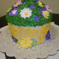 Laarge Cup Cake Flower Pot Used buttercream and royal icing flowers