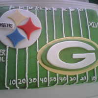Steelers And Greenbay Super Bowl   butter cream frosting and fondant decorations