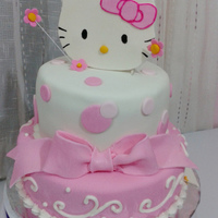 Hello Kitty   Chocolate and vanilla marble cake. Kitty was made from gumpaste. The design was adapted from a picture the customer got online.