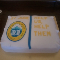St Jude School Cake Donation to help St Jude school in Africa. Didn't quite get the book shape right this time, but was proud of my hand painted logo. TFL...