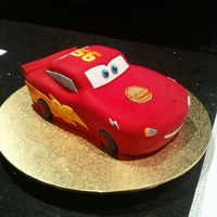 Christopher's Lightning Mcqueen  My first 3D Lightning Mcqueen...made with love for my nephew. Cake is chocolate with dark chocolate ganache. Covered in fondant with hand...