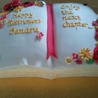Happy Retirement Sandra   Chocolate cake, carved and covered with fondant and handmade fondant decorations. Made with love for a work colleague and friend.
