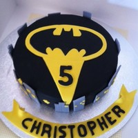 Christopher's Batman Cake Chocolate mud cake, ganached and covered in a fondant Batman design.