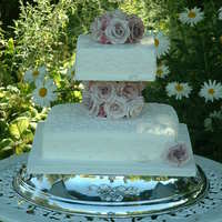 Dusky Rose Wedding Cake Traditional fruit wedding cake with dusky pink gumpaste roses to match the bride's dress. I tried to achieve a guipre lace effect,...