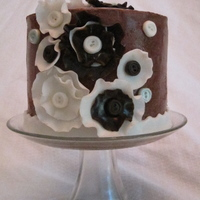 Brown Flowers This cake was inspired by another one I saw here on CC and by my friend Alicia. She makes these type of flowers out of fabric for little...