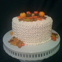 Harvest Cake This is my first attempt at IMBC- i piped it with a petal effect i saw someone do on here. The leaves, acorns, apple baskets and pumpkins...