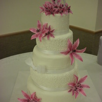5-Tier With Stargazer Lillies For a friends wedding. I ordered the gumpaste flowers online and then colored them.