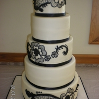 Black And White Wedding Cake This was for a friend's wedding. Based on a design by someone else, not sure who.
