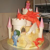 Twins 4Th Birthday Cake For their 4th Birthday my children (boy and girl twins) wanted a dragon, a castle and a princess. I took a Debbie Brown idea and I added a...