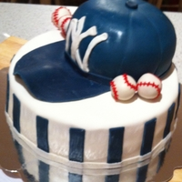 Ny Yankee Hat strawberry cake with buttercream frosting covered in mm fondant