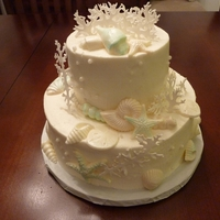 Beach Shower Theme White almond cake with white chocolate seashells.