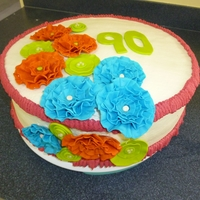 Ruffle Flowers Surprise b-day cake for 90 year old woman. Almond cake with fondant/gumpaste flowers