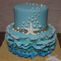 Nautical Ruffle Cake  Strawberry cake with cream cheese filling, covered in buttercream then in fondant. Everything is edible! The starfish, bubbles, rope and...