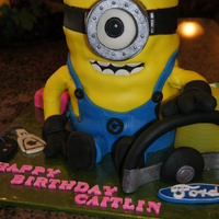 Minion Cake Minion made of cookies & cream cake with cookie dough filling and covered with chocolate frosting. Covered in fondant with fondant...