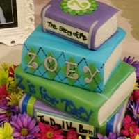 Stack Of Books Baby Shower Book themed baby shower. Flavors were red velvet cake and caramel apple cake.