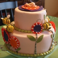 Flowers And Bees Shower Cake Strawberry cake with strawberry and cheesecake filling made up this shower cake for my cousin. The flowers and bees were to coordinate with...