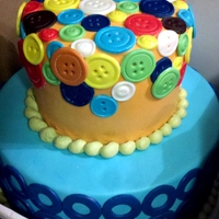Button Cake Button cake for a first birthday. White cake with chocolate mousse filling.