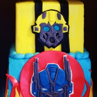 Transformer Birthday Cake Root beer float cake for a 6 year old. Optimus Prime and Bumblebee were hand cut from fondant (as were flames and stripes), otherwise the...