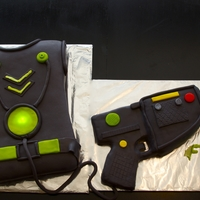 Laser Tag Cake Laser tag vest with RKT laser gun. Disc on the vest lights up. Thanks to kfinaleed for ideas and inspiration. Hers was amazing!