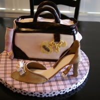 Shoe And Purse Shoe modeled out of gumpaste using tutorial by mrsvb78. Purse inspired by kitagrl. Strawberry cake, with white chocolate SMBC and fresh...