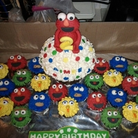 Elmo And Friends Birthday Bash Large giant cupcake with Elmo on top... Cookie monster, oscar, big bird, and elmo cupcakes.