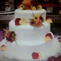 Fall Wedding Cake   fall colored flower decorated cake.
