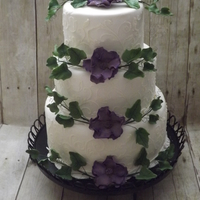 Purple Open Rose With Ivy Leaves Purple open Rose with Ivy leaves and scroll design Wedding or Celebration cake.