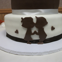 Engagement Cake Kissing Boy And Girl  Saw this cake on Flikr by Bonnie Edwards and had to try it. It was a big hit with the bride and groom to be. Vanilla cake with PB...