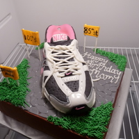Nike Shoe Birthday Cake Nike running shoe cake made with chocolate cake and peanut butter mousse. A client requested for her mom's 85th birthday! It was my...