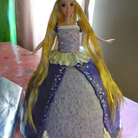 Rapunzel Doll Cake 2nd cake for my niece's 5th birthday. White cake with raspberry curd and lemon cream cheese mousse. The other cake is the tower.