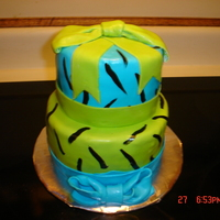 Zebra Print And Bows. Neon green and blue fondant with handpainted zebra stripes.