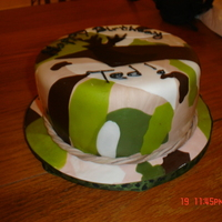 Camo Cake Chocolate cake covered in camo fondant with a deer head stencil airbrushed.