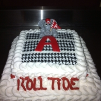 Alabama Cake Frosted with buttercream using the petal technique. First on I have done. Fondant accents and edible image houndstooth.