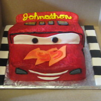 Lightening Mcqueen chocolate cake with BC and fondant accents(smash cake)