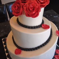 Topsy Roses SImple white base, with black trim. I used chocolate ganache underneath the MMF to give it a more edgy look. The flavors are Pistachio...