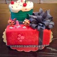 Littlest Pet Shoppe Celebration This was a little cake for my Niece who loves Littlest Pet Shoppe toys...the toys are not cake but everything else %100 edible...the...