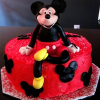 Mickey Mouse Birthday Fondant mickey mouse on top of a chocolate fudge cake with peanut butter mouse filling and vanilla buttercream icing. My best friend sent...