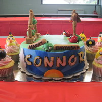 Connor's Cake Angry Birds themed cake for a 6 year old's birthday party. Vanilla cake, strawberry buttercream, MMF.