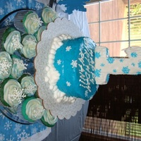 Ryan's 1St Birthday Cupcakes with royal icing snowflake toppers, 6 inch banana smash cake with banana buttercream icing, # 1 is a rice krispie treat with...