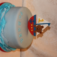 Teddy Bear Nautical 1St Birthday Cake WASC with cookie cream filling. Fondant and fondant waves. Teddy and boat are gumpaste. This is my second fondant cake and I think I'm...