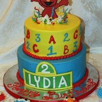 Elmo Jumping Out Of Cake, 2Nd Bday Buttercream with fondant accents. Elmo is gumpaste.