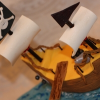 Pirate Ship Birthday Cake 10in square chocolate fudge cake with cookie cream filling and vanilla buttercream. Pirate ship, treasure chest, etc. hand made from...