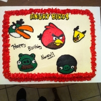 Angry Birds Sheet Cake   I made this cake for a co-worker who loves this game. It was strawberry cake with cream cheese icing. She loved it!