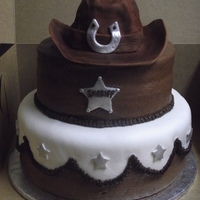 Cowboy Cake   Hat is made of RT covered in fondant. Cake is buttercraem and fondant.