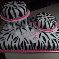 Zebra Print Garduation Cake  Zebra print , made with buttercream icing and choc o pan fondant for the stripes. Was a graduation cake for 4 young ladies graduating. The...