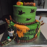 Duck Dynasty   My grandson's birthday cake. Iced with buttercream. Uncle Si, duck call and shotgun shells on top of cake are made from fondant.