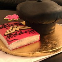 Chef's Hat And Wonder Woman Book A friend ordered this cake for his wife. He calls her wonder woman and she just finished her first year of chef school. I put the wonder...