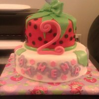 "Strawberry Shortcake 2 tier cake. top tier is strawberry, bottom is vanilla. both iced with vanilla cream cheese icing and covered in fondant. ""2"" is..."